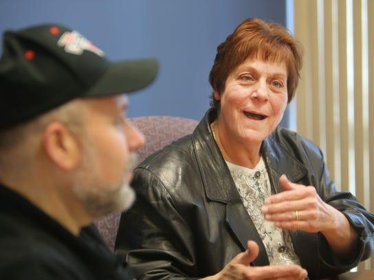The Public Service Credit Union surprised Odette Ferguson