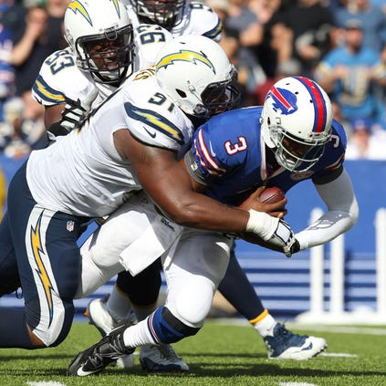 San Diego Chargers defensive end Kendall Reyes (91) sacks Buffalo Bills quarterback EJ Manuel (3) during the second half at Ralph Wilson Stadium. San Diego beats Buffalo 22 to 10.