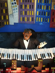 """Wishing Chair Productions puppeteers  give the audience a show during a production of """"Ellingtown,"""" a presentation about Duke Ellington, at the Nashville Public Library."""