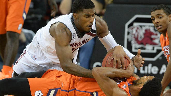 South Carolina guard Duane Notice (10) battles for the ball with Clemson forward Jaron Blossomgame (5) during their game in 2014