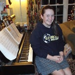 Grace Ringwood, 14, sits at the piano in her Wappingers Falls home. Ringwood took piano lessons as a youngster.