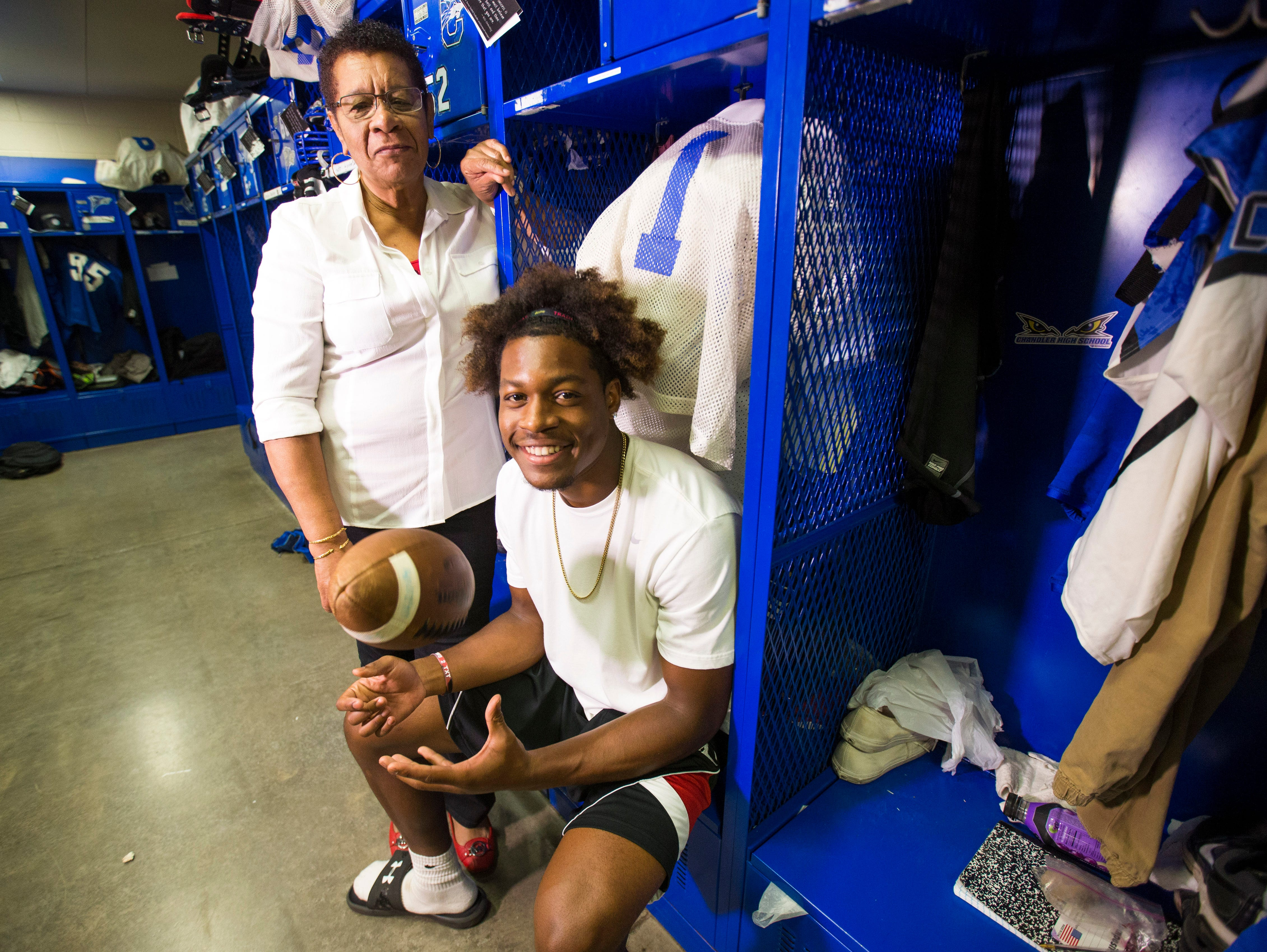 Chandler High's N'Keal Harry poses with his grandmother, Felna, in the football locker room August 25, 2015. Felna brough her grandson over from St. Vincent & the Grenadines for a better life.