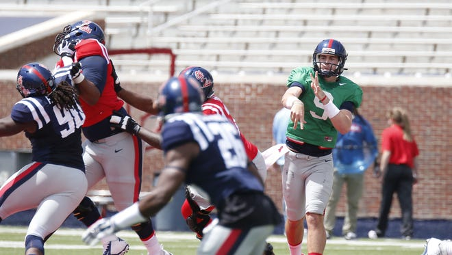 Mississippi Red quarterback Ryan Buchanan (9) passes down the line against the Blue team during their spring college football game, Saturday, April 11, 2015, in Oxford, Miss. (AP Photo/Rogelio V. Solis)