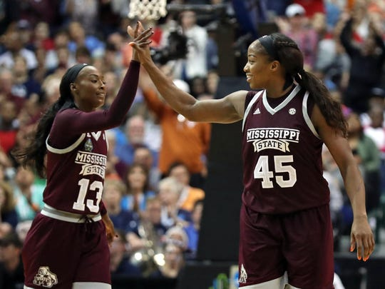Mar 31, 2017; Dallas, TX, USA; Mississippi State Lady Bulldogs center Chinwe Okorie (45) reacts with forward Ketara Chapel (13) in the fourth quarter against the Connecticut Huskies in the semifinals of the women's Final Four at American Airlines Center. Mandatory Credit: Matthew Emmons-USA TODAY Sports