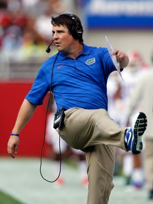 Florida head coach Will Muschamp reacts to a field goal during the first half of an NCAA college football game against Alabama on Saturday, Sept. 20, 2014, in Tuscaloosa, Ala. (AP Photo/Butch Dill)