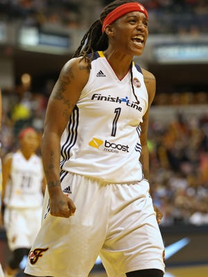 Shavonte Zellous celebrates Indiana's lead at the half 44-42, of the Indiana Fever vs Chicago Sky Eastern Conference Finals game 2 at Bankers Life Fieldhouse, Saturday, September 19, 2015.