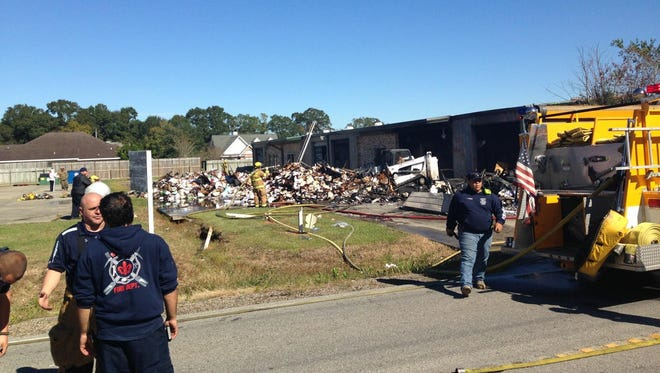 Authorities at the scene of a fire at a business Friday morning found a body inside a vehicle at the site.