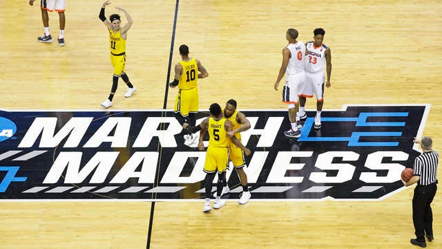 In this March 16, 2018 file photo, UMBC players celebrate their 74-54 win over Virginia in a first-round game in the NCAA men's college basketball tournament in Charlotte, N.C.