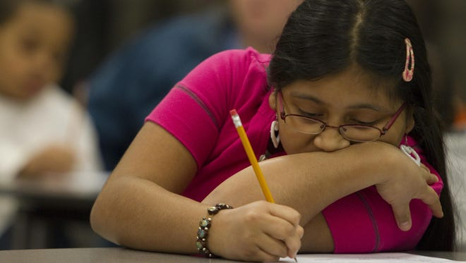 Delmy Hernandez, 11, works on a logic and math problem at an event at Crooked Creek Elementary School to prep for an upcoming ISTEP test, Indianapolis, IN, Thursday, February 25, 2010. (Robert Scheer/The Indianapolis Star)