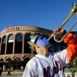 Andy Aponte, from Bronx, NY, plays a bugle outside of Citi Field before Game 3 of the Major League Baseball World Series between the New York Mets and the Kansas City Royals Friday, Oct. 30, 2015, in New York.