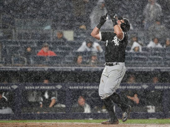 New White Sox catcher James McCann celebrates a home run in the rain this month.