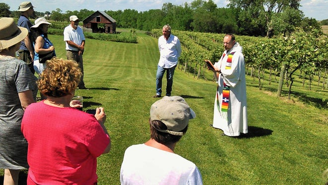 Father Jason Crossen of Bettendorf blessed the vineyards at Ardon Creek Winery on Memorial Day weekend in the rolling hills near Letts.