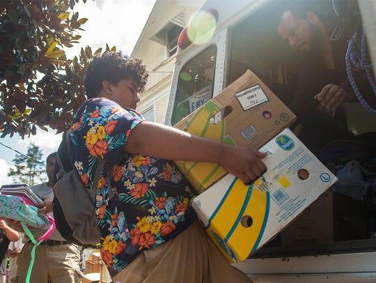 The nephew of Ponkho Bermejo, right, helps him load