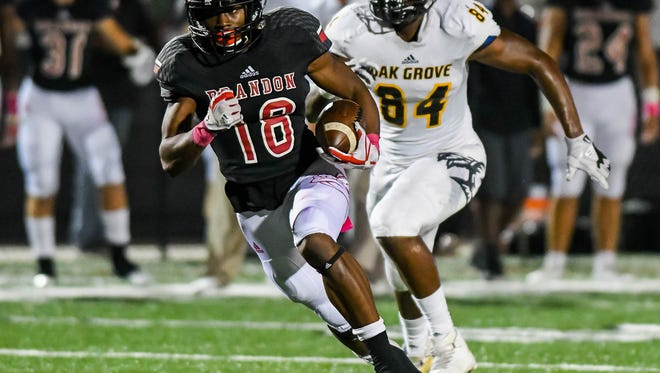 Brandon's Jonathan Mingo (18) scores a touchdown against Oak Grove during game action Friday, October 20th, 2017 in Brandon, MS.(Bob Smith-For the Clarion Ledger)