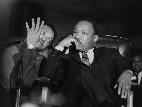Martin Luther King Jr., seated with aide Jesse Jackson, arrives at the Mason Temple in Memphis on April 3, 1968. MLK Day is Jan. 21.