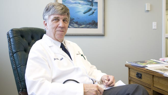 Dr. Jim Blaine in his office at an OTC health clinic in 2013. He has chaired the DWI Task Force since 1990.