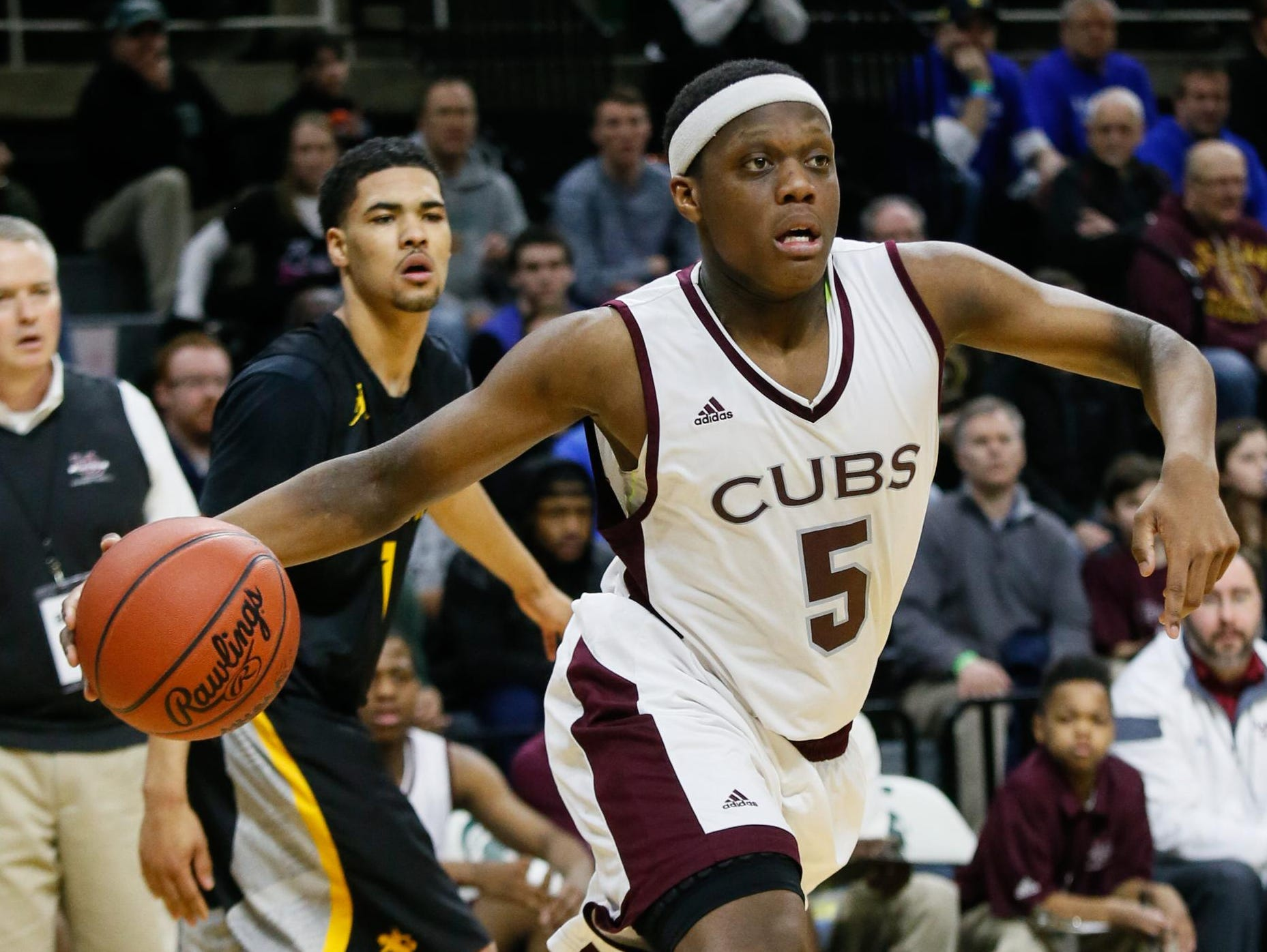 U-D Jesuit's Cassius Winston scores 31 points against North Farmington to win the MHSAA boys basketball Class A championship 69-49 at the Breslin Center on March 26.
