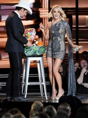 Hosts Brad Paisley and Carrie Underwood show off the