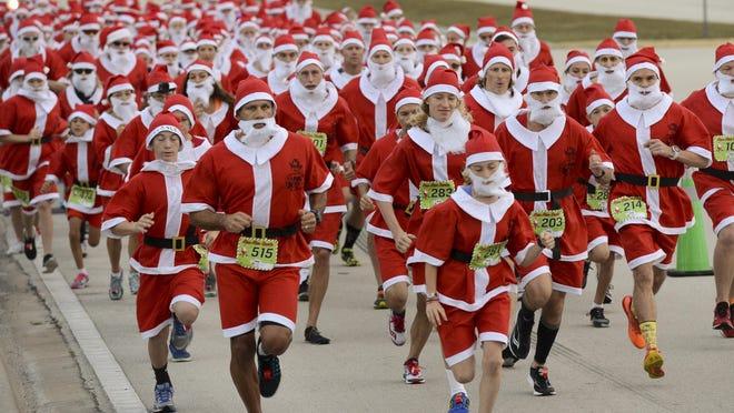 Over 500 runners dressed as Santa Claus participate in Saturday's Run Run Santa 1Mile race in Viera.