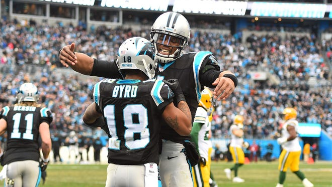 Carolina Panthers wide receiver Damiere Byrd (18) celebrates with quarterback Cam Newton (1) after scoring a touchdown in the third quarter at Bank of America Stadium.