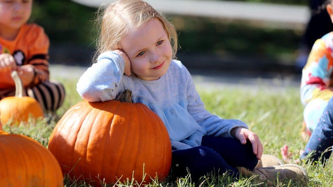 Wynter Irvin, 4, relaxes after a trip through the Lafayette Street United Methodist Church pumpkin patch on Wednesday.