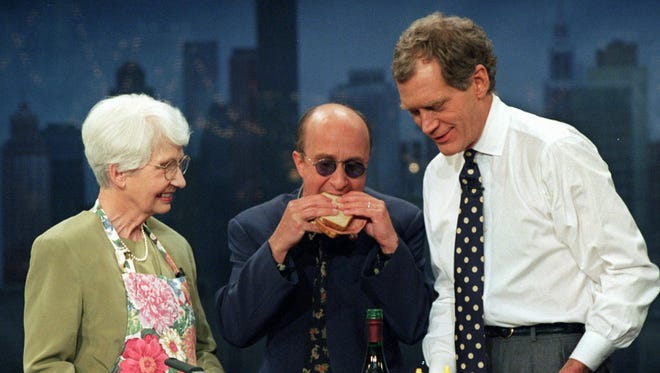 "Paul Shaffer, center, samples one of Dorothy Mengering's fried baloney sandwiches on a 1996 episode of ""Late Show with David Letterman."""