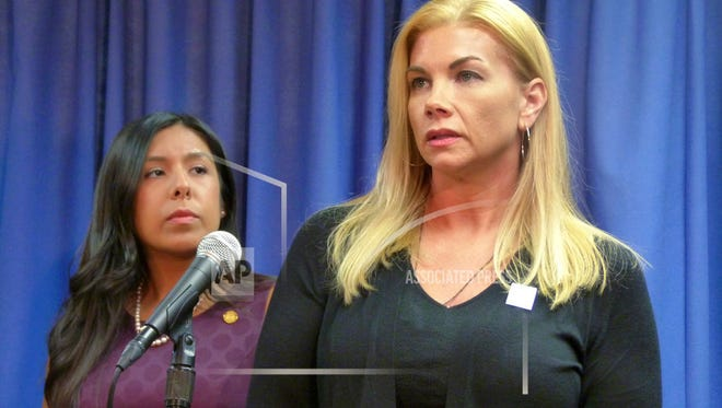 Domestic violence survivor Nicole Beverly speaks during a news conference at the House Office Building Thursday, Nov. 9, 2017 in Lansing, Mich. She supports newly introduced legislation aimed at helping victims with address confidentiality and other protections. At left is a bill sponsor, Democratic Rep. Vanessa Guerra of Saginaw.