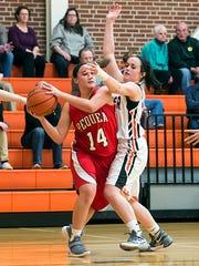 Pequea Valley's Megan Stoltzfus (14) passes the ball