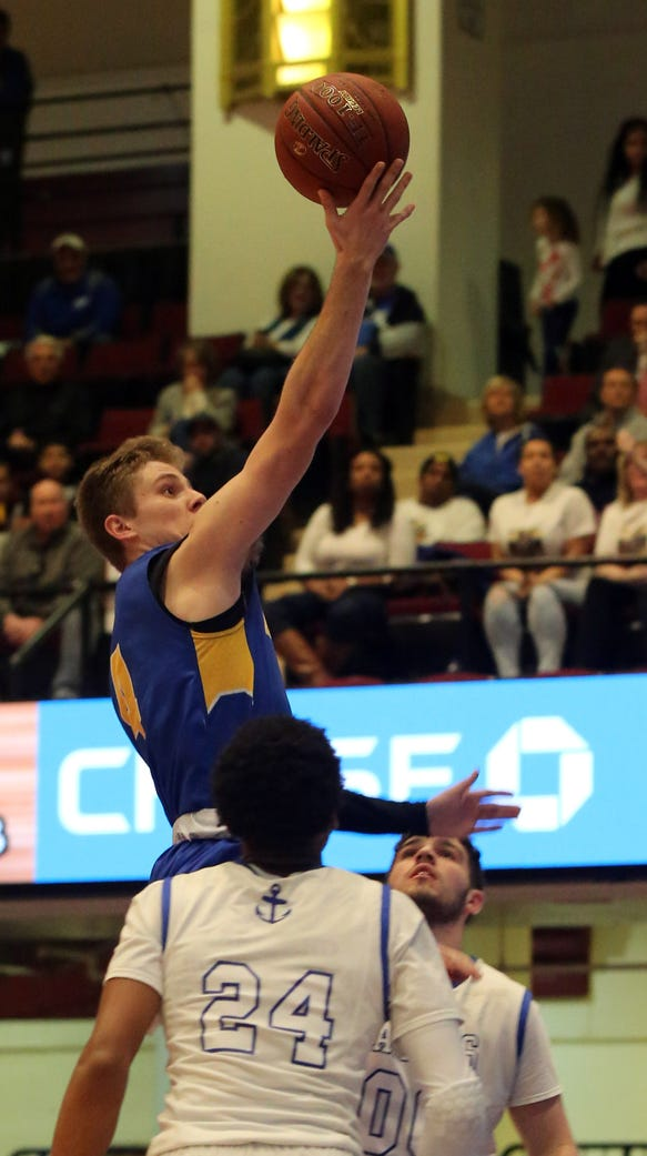 Ardsley's Sean Casey (4) goes up for two during boys