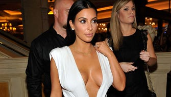 Kim's waist looks cinched here, but is anyone looking at her waist?