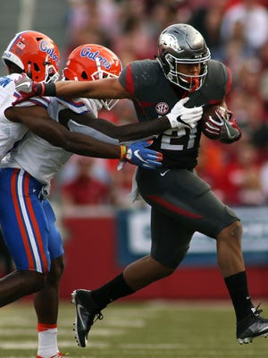 In this file photo, Arkansas' Devwah Whaley (21) pulls away Florida's defense during a game at Razorback Stadium in Fayetteville.