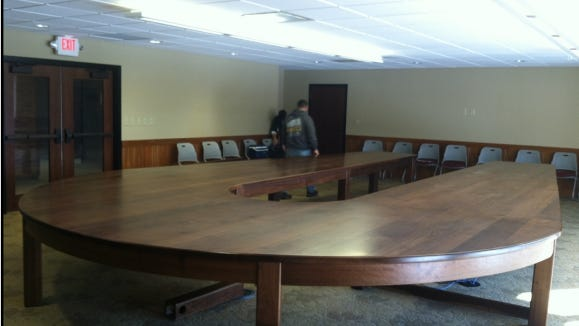 "This ""extravagant and grandiose"" 1.2-ton, handmade walnut conference table was illegally installed at Ohio Department of Natural Resources headquarters in Columbus."