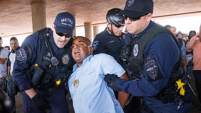 The Rev. Jarrett Maupin was one of three demonstrators arrested at a police-violence protest in Tempe on Sept. 26, 2016.
