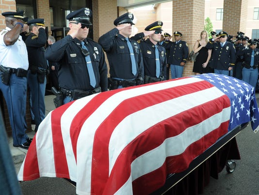 thousands turn out for miss police officer s funeral