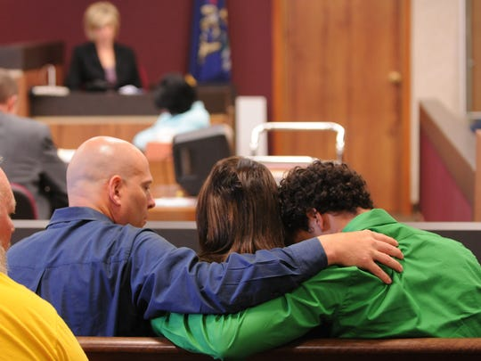 Mara McCalmon, who survived a violent attack that killed her husband in November 2010, will share her story March 14 in Port Huron as part of a conference on trauma. Pictured, her family supports her during a 2011 trial.