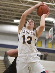 Madi Moyer of Hartland goes to the basket in a season-opening