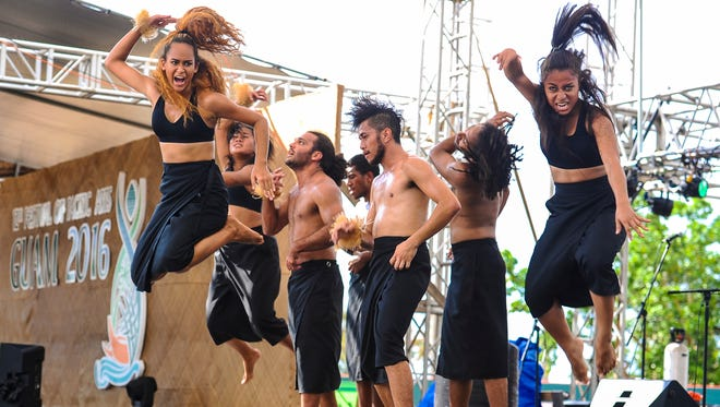 The VOU Dance Group, with the Fiji delegation, presents a dance performance as a tribute to the victims of Cyclone Winston during the 12th Festival of Pacific Arts at the Paseo Stadium in Hagatna on Friday, June 3. Cyclone Winston reportedly killed dozens of Fijian and left thousands homeless after it swept through the islands in February.