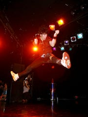 LOS ANGELES, CA - JUNE 28: Gordon 'Krye Tuff' Hintz jumps as he competes in the West Coast Regionals and U.S. Finals of the United States Air Guitar Championships at the Roxy on the Sunset Strip on June 28, 2003 in Los Angeles, California.
