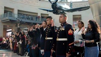Marines naturalized as U.S. citizens in Triangle, Va., in 2014.