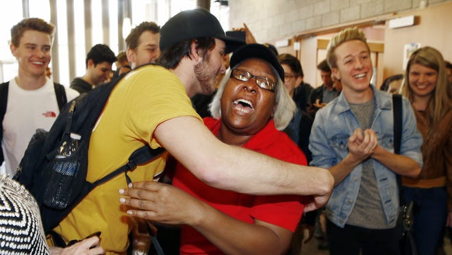 ASU sophomore Chase Ebiner (left) hugs from dining room cashier Vicke Davis after she received a $2,350 check for her dream trip on Jan. 21, 2016, at Barrett, the Honors College at Arizona State University in Tempe.