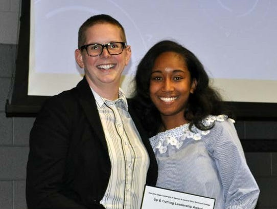 Deonna Durrett, right, is honored for her work.