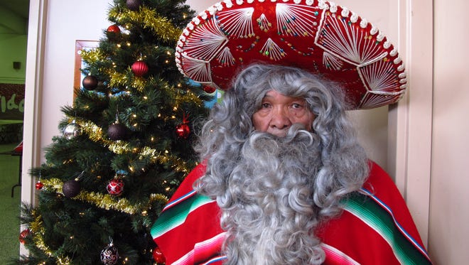 Julian Perez stands in his Pancho Claus suit in Lubbock, Texas.