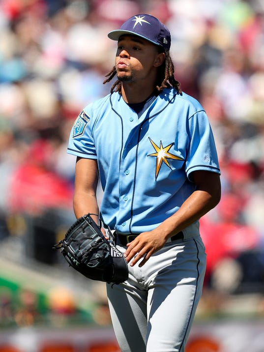 Tampa Bay Rays pitcher Chris Archer walks off the field after the first inning of a spring training baseball game against the Philadelphia Phillies, Tuesday, March 13, 2018. in Clearwater, Fla. (Monica Herndon/Tampa Bay Times via AP)