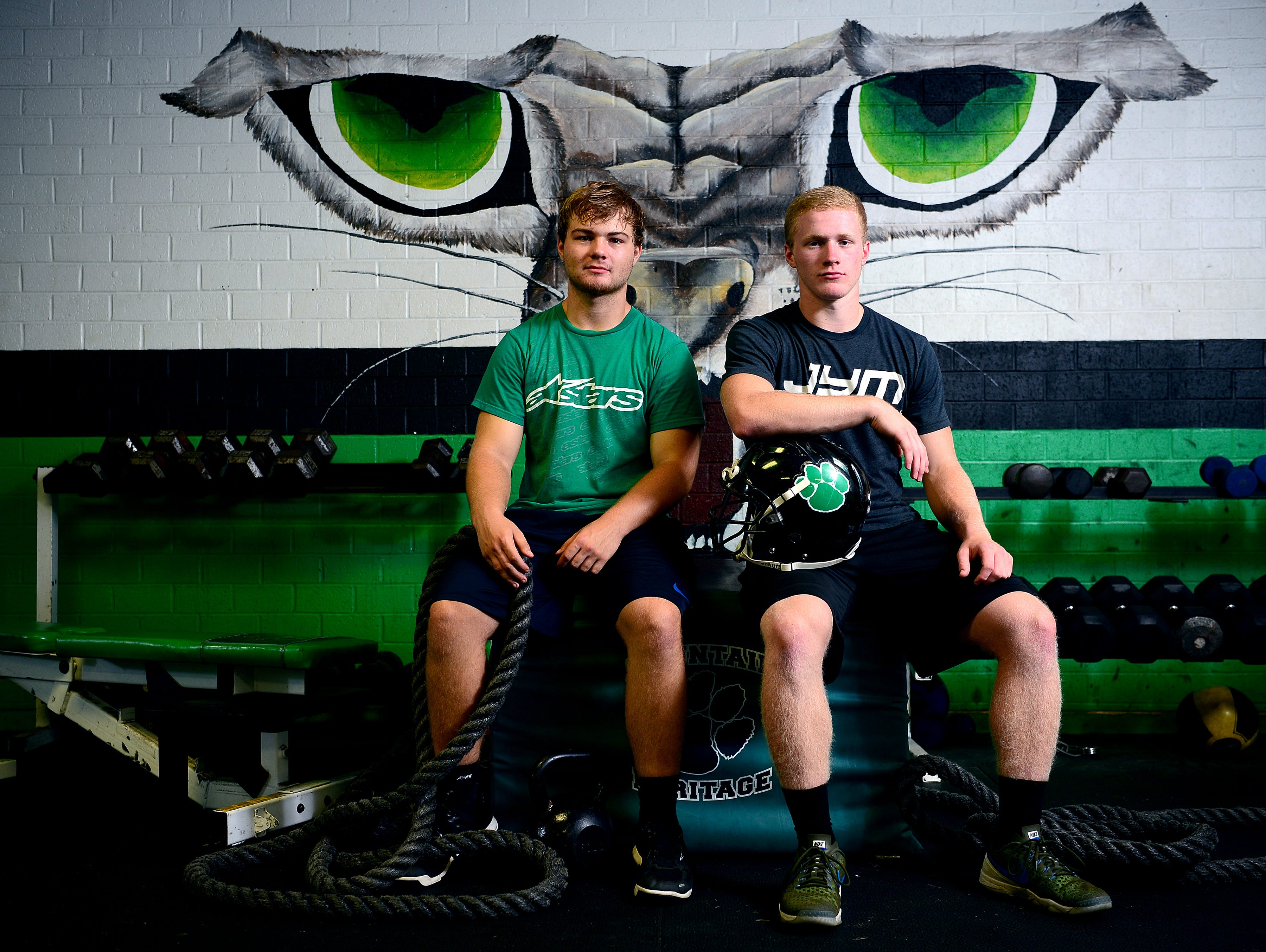 Mountain Heritage's Trey Robinson, right, and Adam Shuford.