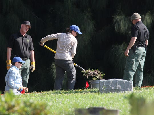 Martin County Sheriff's Office investigators and Florida Gulf Coast University forensic anthropologists (center) uncover a gravesite at Fernhill Memorial Garden and Mausoleum on Kanner Highway in Stuart in January, while looking for clues in search of Baby Moses. Three grave plots marked as unknown infant at the cemetery were being exhumed for DNA evidence to help with identifying the body of an infant, now known as baby Moses, found drowned in an canal in November of 1983.