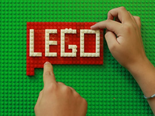 Ensor Middle School students position LEGO blocks on
