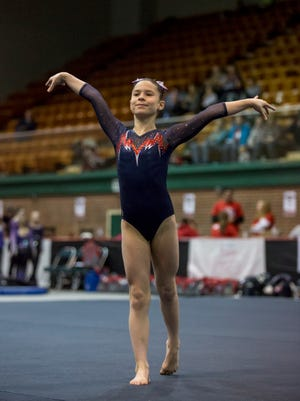 All American Flames' Victoria Guerette, 8, competes in the floor routine during the WildFire Challenge gymnastics competition Saturday, Feb. 27, 2016 at McMorran Arena.