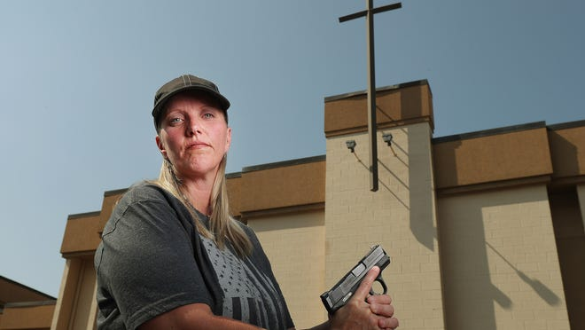 Connie Peterson stands outside the Salt Lake Christian Center where she attends church in Millcreek on Wednesday, Aug. 1, 2018. Peterson has a concealed gun during worship.