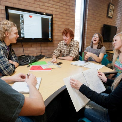 A group of University of Montana students study. Enrolled