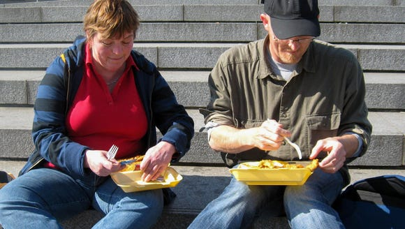 Enjoying our hot fish and chips on the steps.
